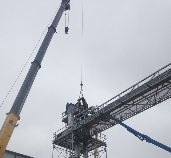 Removing bucket elevator belt and buckets with a crane